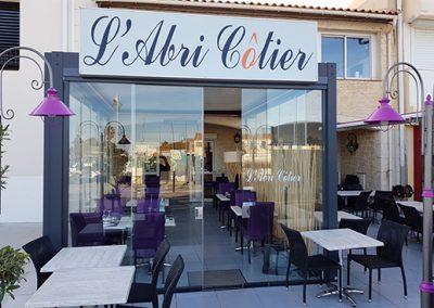 Terrasse de restaurant en verres coulissant pour une exploitation toute l'année à Marseillan à coté de Sète 34 Herault